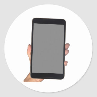 Holding a phablet classic round sticker