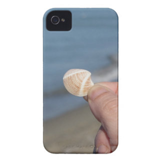Holding a seashell in the hand iPhone 4 case