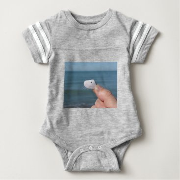 Beach Themed Holding a seashell in the hand with blue sea baby bodysuit