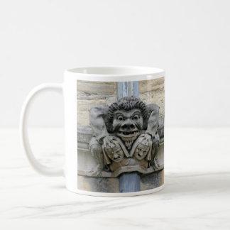 Holding-down-heads gargoyle mug