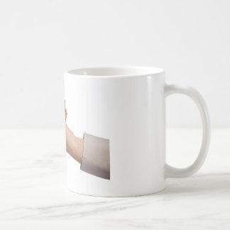 Holding money coffee mug