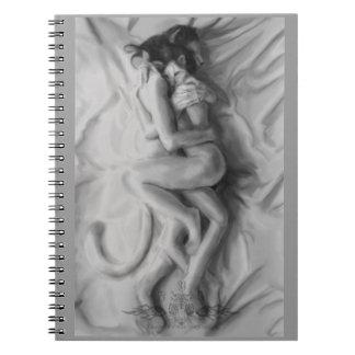Holding my heart spiral notebook