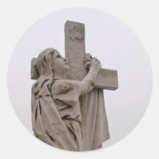 Holding the cross sticker