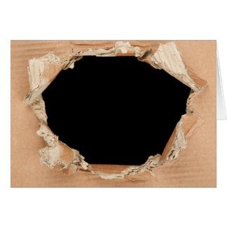 Hole in cardboard card