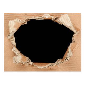 Hole in cardboard postcard