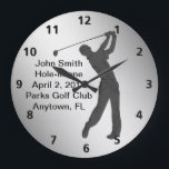 """Hole-in-one Golf Swinger Customizable Large Clock<br><div class=""""desc"""">The silhouette outline of a golfer swing his club is sure to please the golf lover.  The caption is for commemorating a hole-in-one.   It is a template and can easily be changed or removed.</div>"""