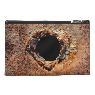 Hole in rust travel accessories bag