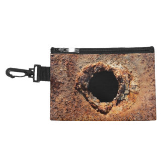 Hole in rust accessories bag