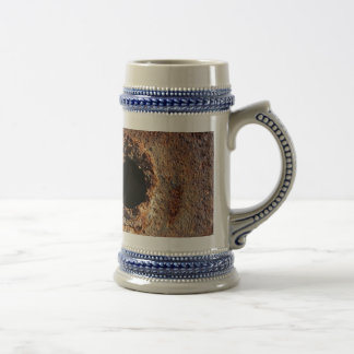 Hole in rust beer stein