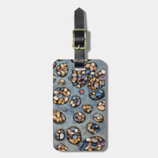 Holes filled with pebbles, CA Luggage Tag