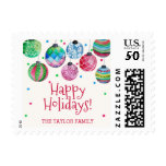Holiday Ornament Christmas Postage<br><div class='desc'>These holiday ornament christmas postage stamps are perfect for a festive holiday card or invitation. The watercolor design features dangling colorful christmas baubles with red green and blue confetti. Personalize the stamps with your name or a short message.</div>