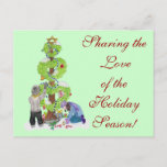 """Holiday Postcard<br><div class=""""desc"""">This postcard was created with love for the winter holiday season. It depicts two children decorating a tree of love with multi-cultural decorations. It is a unique design to welcome the holidays in any household.</div>"""