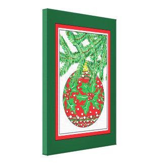 Holly Glass Ball Ornament on Christmas Tree Canvas Print