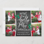 "Holly Jolly | Holiday Photo Collage Card<br><div class=""desc"">Rustic and whimsical holiday photo card features four photos in a collage layout, with ""have a holly jolly Christmas"" in white hand lettered typography on a chalkboard background, accented with red and green holly leaves and berries. Personalize with your names beneath, and add an additional photo to the back on...</div>"