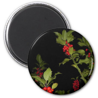holly tree on black background 2 inch round magnet