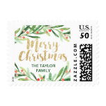 Holly Wreath Merry Christmas Postage<br><div class='desc'>These holly wreath merry christmas postage stamps are perfect for a classic holiday card or invitation. The design features a watercolor green wreath with red berries and an elegant faux gold glitter font. Personalize the stamps with your name or a short message. Please Note: This design does not feature real...</div>