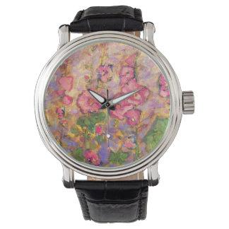 hollyhocks blooming watch
