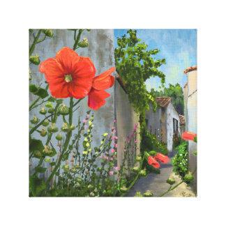 Hollyhocks In A French Alley Canvas Print