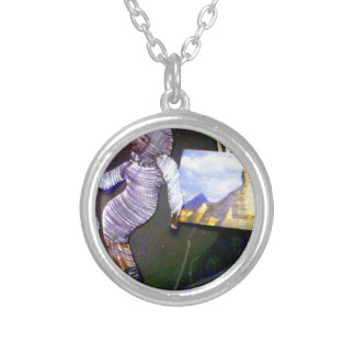 holographic image projected from the time machine silver plated necklace