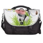Holstein cow in grass commuter bag