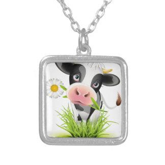 Holstein cow in grass necklace