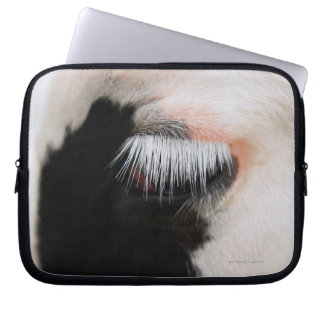 Holstein cow's face, close-up of eye laptop sleeves