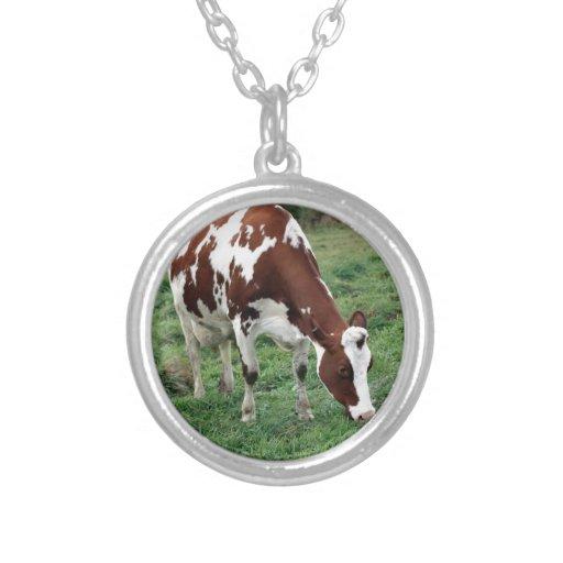 Holstein roja y blanca que pasta colgante redondo