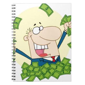 Hombre con mucho dinero libretas espirales
