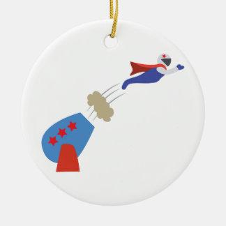 Hombre de la bola de cañón adorno navideño redondo de cerámica