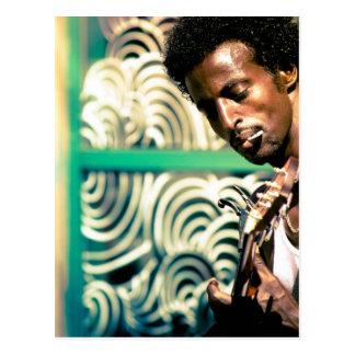 Hombre de la guitarra del reggae postales