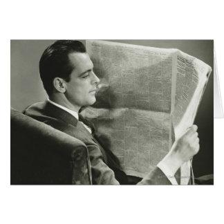 Hombre de negocios que lee el periódico tarjeta de felicitación
