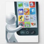 Hombre de plata y teléfono celular gigante placa de plastico