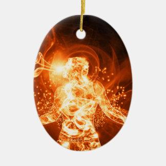Hombre del fuego adorno navideño ovalado de cerámica
