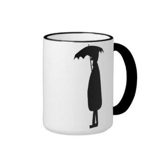 Hombre en la taza de la lluvia