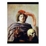 Hombre joven con un cráneo postales