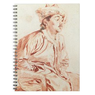 Hombre joven en el traje oriental (dibujo) libro de apuntes con espiral