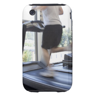 Hombre joven que corre en una rueda de ardilla en  iPhone 3 tough fundas