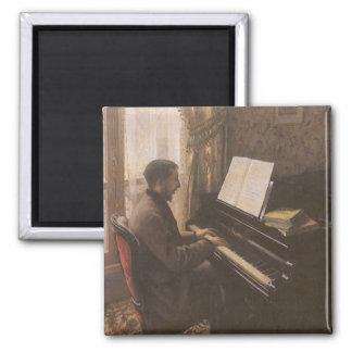 Hombre joven que juega el piano de Gustave Imán Cuadrado