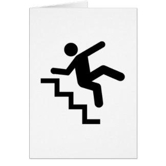 Hombre que cae abajo las escaleras tarjeton
