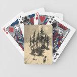 Hombre que mira árboles con el dólar, ardilla, con barajas de cartas