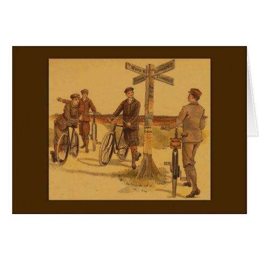 Hombres del vintage en saludos de las bicicletas tarjeta