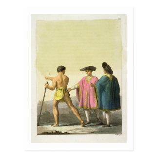 Hombres que llevan los ponchos ceremoniales en postal
