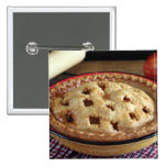 Home baked apple pie on cooling rack with apple 2 inch square button