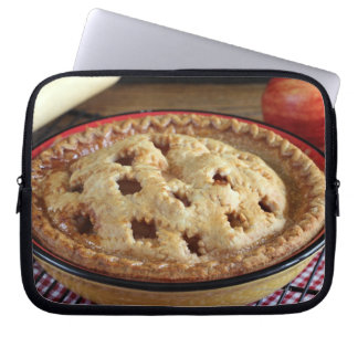 Home baked apple pie on cooling rack with apple laptop sleeve