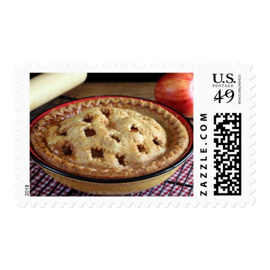 Home baked apple pie on cooling rack with apple postage