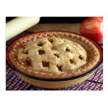Home baked apple pie on cooling rack with apple postcard