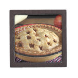 Home baked apple pie on cooling rack with apple premium keepsake boxes