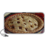 Home baked apple pie on cooling rack with apple travel speaker