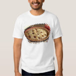 Home baked apple pie on cooling rack with apple t-shirt
