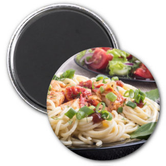 Home-cooked meals on a gray mat - spaghetti magnet